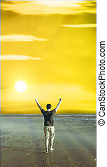 Freedom - energetic and satisfied man on the beach