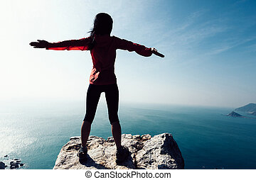 freedom female standing with outstretched arms on sunrise ...