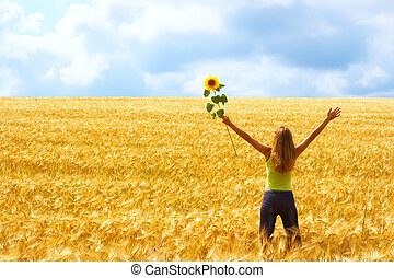 Freedom - Happy young woman in the field