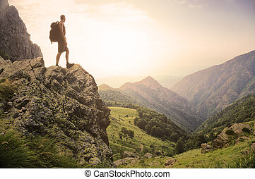 Freedom in the natural world - Healthy young man standing on...