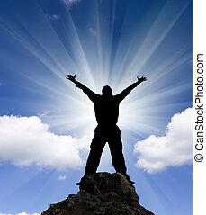 jumping man against blue sky.