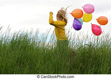 Freedom - Little girl playing with balloons