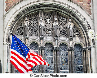 The flag waving in front of St Bart's Episcopal Church in New York City.