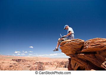 Freedom - USA. Arizona. Page. Horseshoe Bend. Man with...