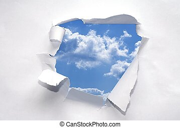 Freedom - Paper with ripped center and blue sky showing...