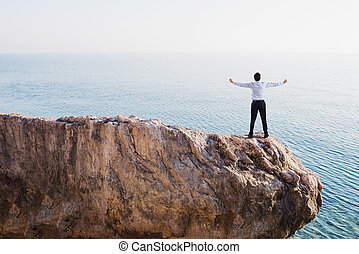 Freedom successful businessman over a high mountain
