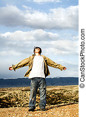 freedom - teen with arms with open - freedom - teenager male...