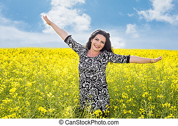 Freedom woman in canola field