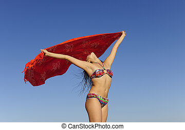 freedom: woman with beach towel against blue sky - woman...
