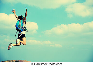freedom young asian woman jumping