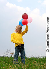 Freedom - Young girl playing with balloons
