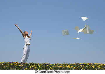 Freeing from paperwork - Laughing girl throws in air blank...