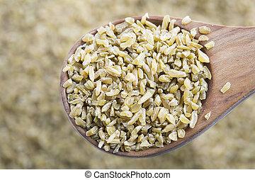 Freekeh in Wooden Spoon - Healthy Freekeh in wooden spoon.