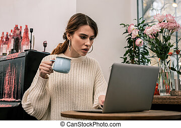 Freelancer working in a cafe with her computer