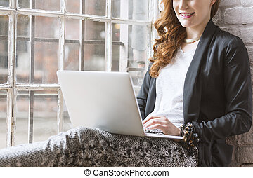 Freelancer working on computer in home