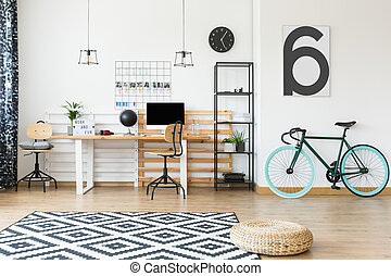 Freelancer's open space apartment - Wicker pouf and dark...