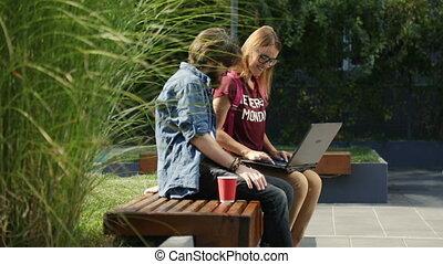 Freelancers Work Outdoors - Professional freelancers working...