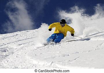 Freeride Skier . - Freeride skier in powder snow against...