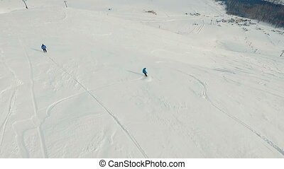 Freeride snowboarding. Aerial shot. - Freeride snowboarding...