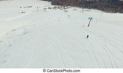 Freeride snowboarding near the ski-lift. Aerial shot. -...