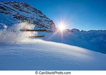 Freerider skier jumping in fresh powder snow in beautiful...