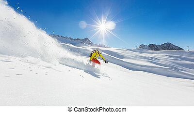 Freerider snowboarder running downhill in beautiful Alpine...