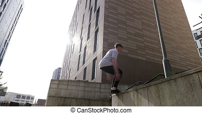 Freerunner Doing Flips in the City - Free runner is doing a...