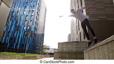 Freerunner Doing Flips in the City - Freerunner is doing a...