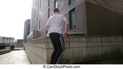 Freerunner Jumping Between Walls - Freerunner is jumping...