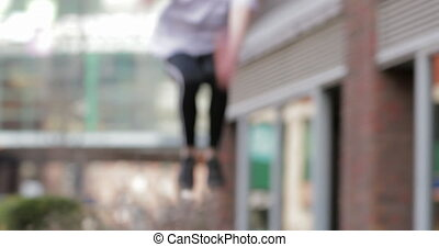 Freerunner Jumping over Railings - Freerunner is jumping...