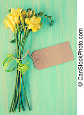 Freesia flowers with blank tag