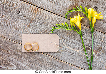 Freesia with blank tag and wedding rings