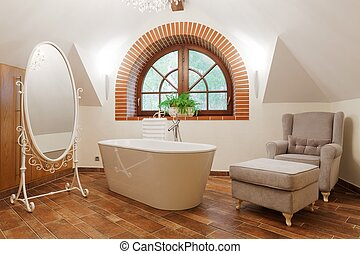 Freestanding bath in designed restroom - White freestanding...