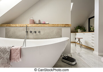 Freestanding bath in grey bathroom - Freestanding bath with...