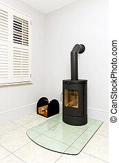 Freestanding wood stove - Freestanding black cast iron wood...