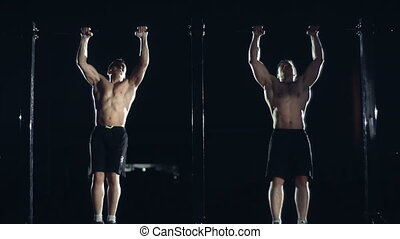 Freestyle Calisthenics - Close up of two athletes performing...