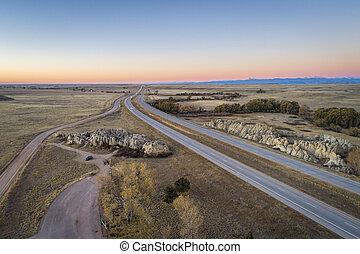 freeway across rolling prairie