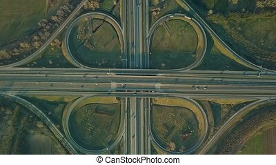 Freeway cloverleaf interchange - Highway intersection aerial...