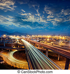 freeway - Freeway in night with cars light in modern city