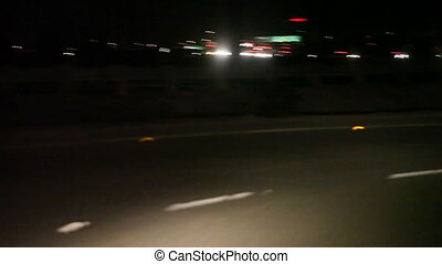 merging onto a California freeway at night