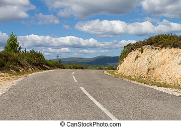 Freeway on Hills - Empty secondary downhill road against...