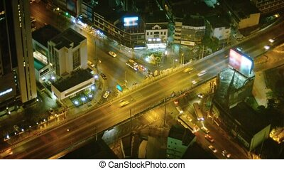 Freeway Overpass with Light Traffic in Downtown Bangkok at Night