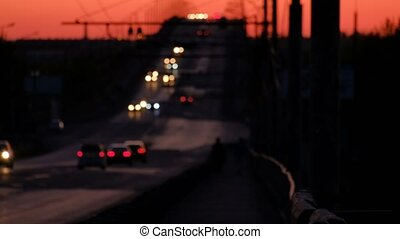 Freeway traffic defocused at sunset. Astrakhan Russia.