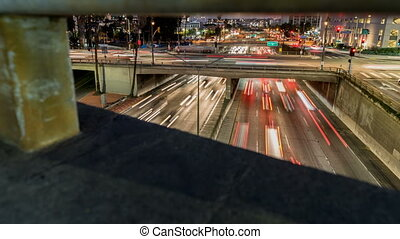 Freeway Traffic Time-lapse - Tracking shot moving along a...