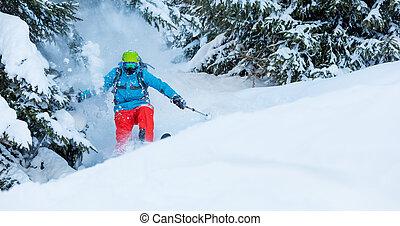 Freeze motion of freerider in deep powder snow, skiing in...