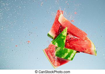 Freeze motion of fresh melon with splashing water