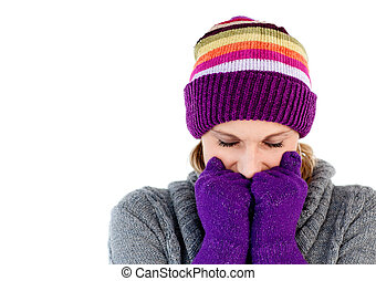 Freeze woman with gloves and a hat closing her eyes
