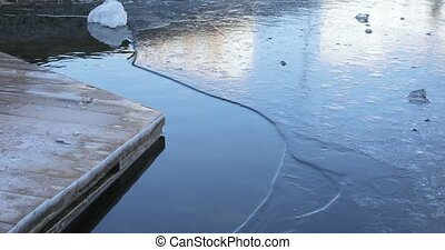 Freezing pond and a wooden house - Near the wooden wooden...