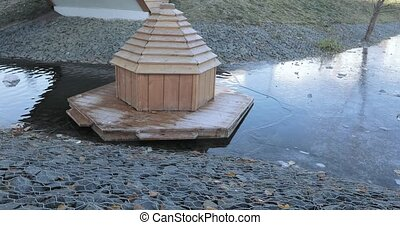 Freezing pond and a wooden house