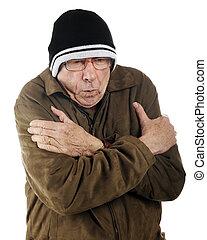 Freezing Senior - A senior man in ski cap and thin jacket...